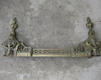 Antique French brass fire trim.