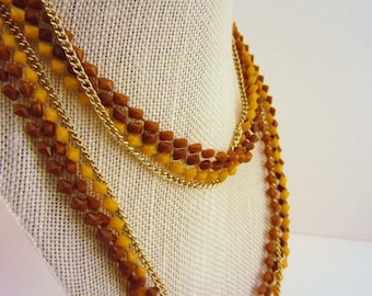Long necklace. Vintage jewelry. Gold chain, mustard yellow, chocolate brown, tan. Four strand. Single or double strand. Statement jewelry.