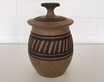 Legatha Walston lidded ceramic jar with incised/carved decoration