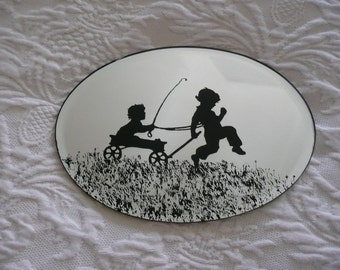 Etched mirror of boys in a wagon