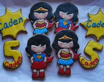 wonder woman and super girl cookies