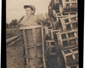 vintage photo Young Man Squeezed into a basket unusual Vintage Snapshot