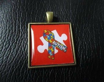 Red Autism awareness  square pendant no chain is included