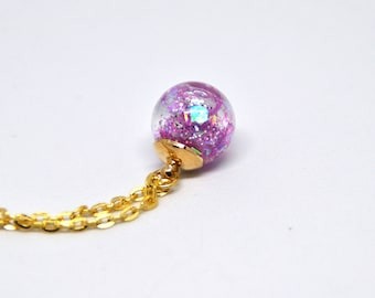 Boreal aurora sky necklace with glass ball pendant with glitter pink, bright, gold chain