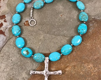 Southwestern style turquoise howlite necklace with a rustic cross pendant