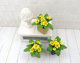 Pot of yellow primroses for dollhouse in 1:12 scale