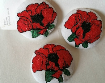 Remembrance Poppy. Textile Art brooch/ Badge. Created using free motion embroidery. Donation made per poppy sold.