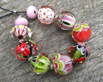 Handmade lampwork beads, clear encased round artisan glass beads, red pink green black white - Annikalilly 's Lampwork - set 9 + 6 intricate