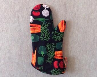 Vegetable print on ebony black background oven mitt