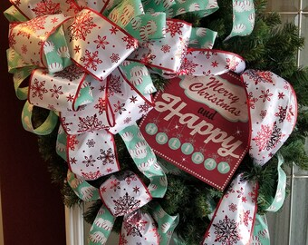 """24"""" artificial evergreen wreath with holiday decor"""