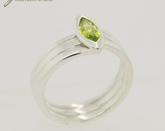 Marquis cut Peridot in bezel setting with Sterling Silver coils Ring