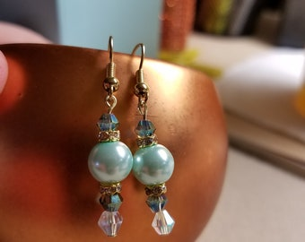 Teal pearl earrings with gold rhinestones.