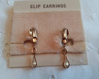 Vintage dangling pearl clip on earrings in gold tone