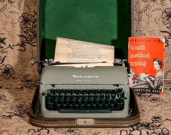 1950s Remington Quiet Riter with Original Touch Method Typing Book Green