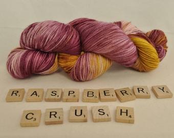 "Hand-dyed yarn, ""Raspberry Crush"" variegated, soft and squishy yarn. Great for socks or shawls. 80/20 Superwash wool/Nylon"