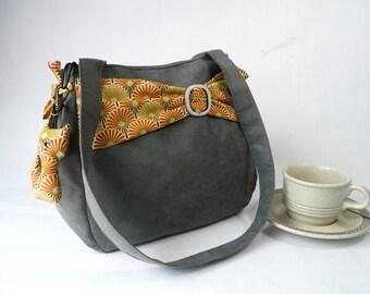 Grey and yellow shoulder bag,  grey bag with yellow belt, grey handbag