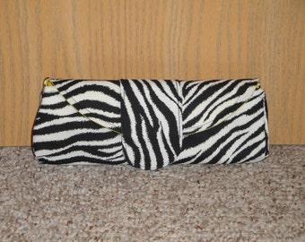 REMY- Zebra print clutch