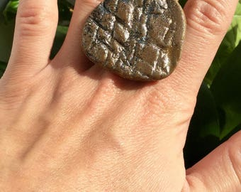 Brown, slightly iridescent, textured ring