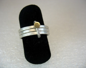 Trio and the Dot - silver hammered bands with gold, stacking together.