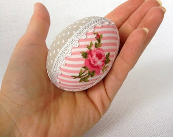 Easter egg with cotton and ribbon, pysanka