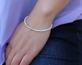 Thin seed bead and silver bar bracelet.