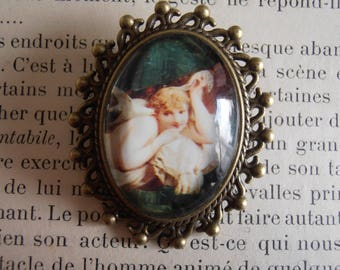 Brooch with woman and bird cabochon