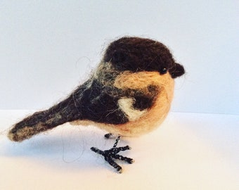 Needlefelt bird