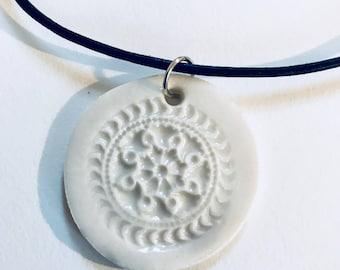 Porcelain stamped pendant