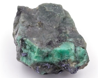 Raw emerald stone of 80 grams with matrix of black mica and quartz.