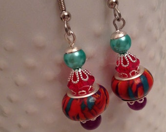 European Style Multi Colored Dangle Pierced Earrings.  Red, Purple, Green, Yellow and Teal swirl bead. Red, purple bead and mint pearl bead.