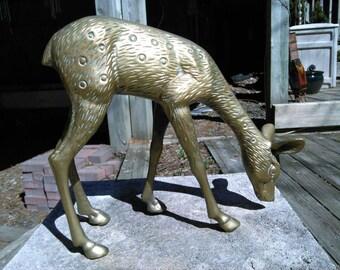 Large brass grazing deer