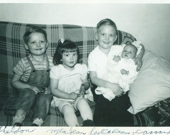 1950s New Baby Sister Makes Four Brothers Sister Sitting on Couch Family Boys 50s Vintage Photograph Black White Photo