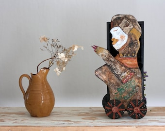 A Secret Woman - paper mache and mixed media folk art sculpture of a woman with two different sides