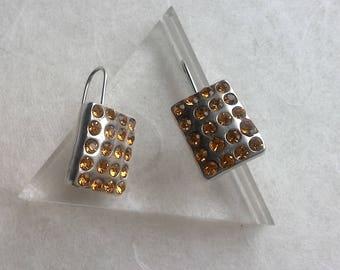 Stud Earrings, pierced Duo.metal brand silver and yellow rhinestones. Paris.