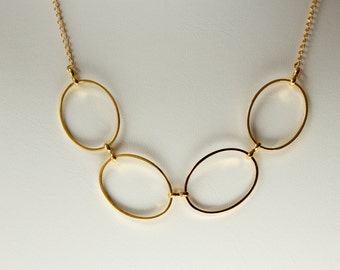 large gold circle necklace, gold circle necklace, connected circle necklace, multi circle gold necklace, gold eternity necklace