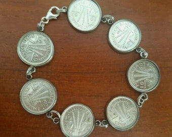 Predecimal Australian threepence bracelet in stainless steel / 7 coins different years / 1949 -1961