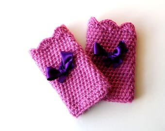 Fingerless gloves crocheted wool old rose color adorned with a pretty purple satin ribbon.