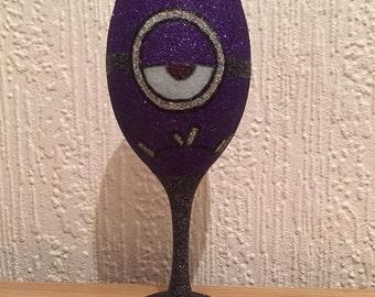 Purple evil minion inspired glitter wine glass