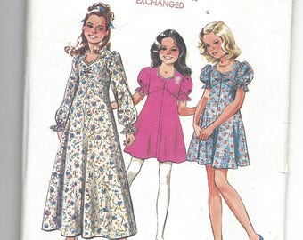 Vintage 1974 Pattern. Simplicity 6538  Girls Empire waist Sweetheart neck dress in two lengths with long or short sleeves Size 12 breast 30