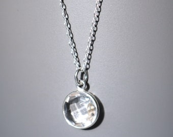 Sterling Silver Clear Quartz Charm Pendant Necklace with Faceted Stone Bezel Set.