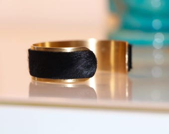 Matte gold plated brass and black foal leather Cuff Bracelet. Leather strap.