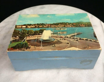Working music box with vintage city on front