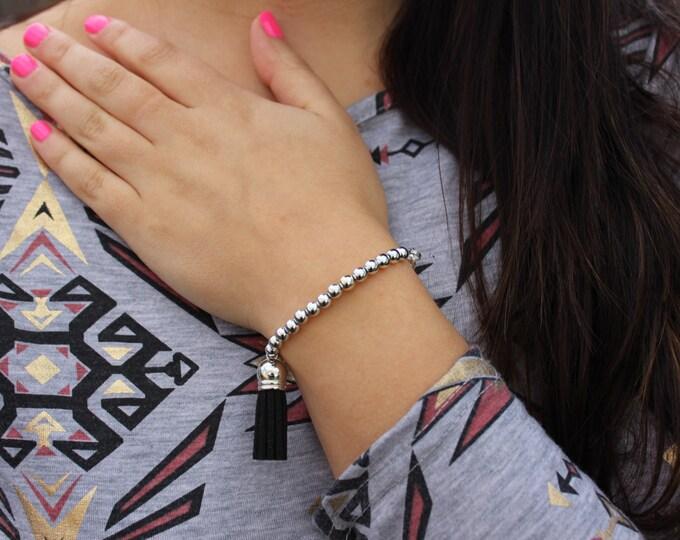 Black and Silver Beaded Tassel Bracelet.