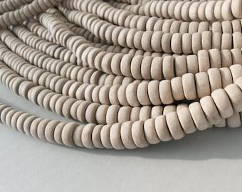 45 perles rondelles de bois naturel de 4 x 10mm