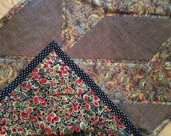 Reversible table runner featuring pieced quilt in fall colors with gold accent on one side and winter berry with gold on the other.
