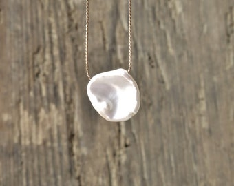 Freshwater pearl necklace. Keshi pearl necklace. Minimalist necklace with a petal shaped freshwater bead. June birthstone.