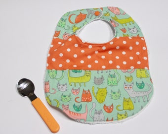 Fantasy bicolor green with cats and orange polka dots white back in cotton sponge and closure with pressure button