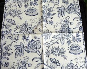 Blue stylized flowers on cream background paper towel
