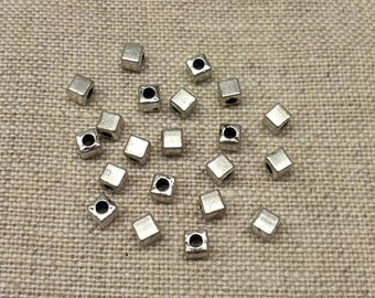 Set of 30 silver T27 cube beads