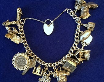 Silver Charm Bracelet with Heart Lock and Eighteen Silver & Plated Unusual Charms